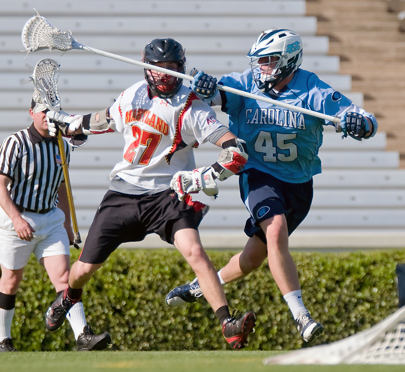 24 April 2009:Maryland's sophomore attack #27 Ryan Young  drives on UNC's Freshman defense #45 Charlie McComas