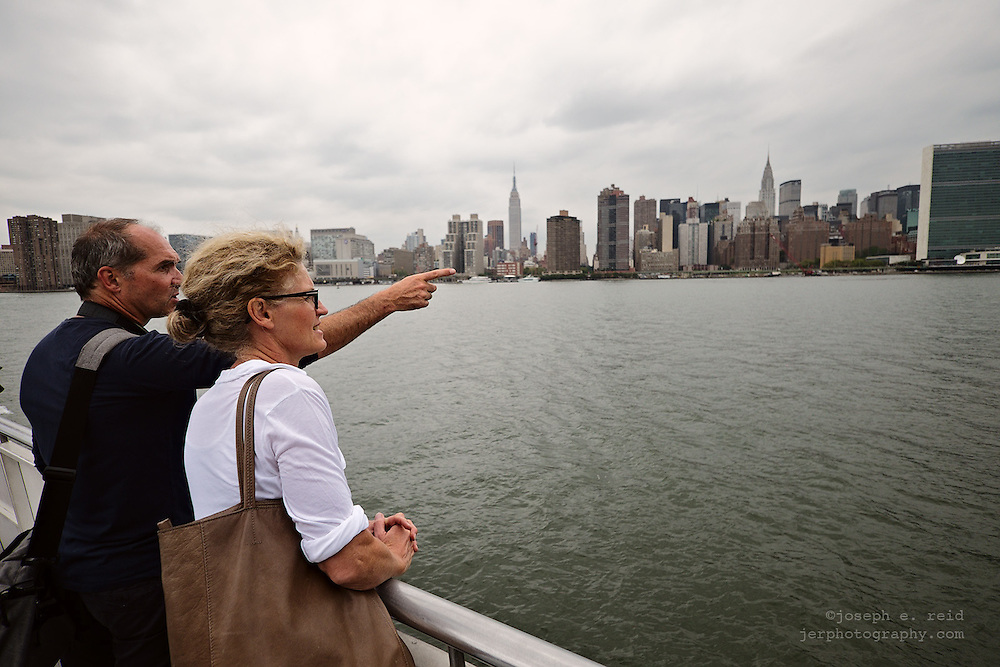 Tourists on ferry on East River, New York, NY, US