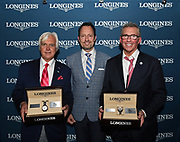 Pascal Savoy, center, Longines US Brand President, presents Longines Conquest Classic Collection timepieces to trainer Bob Baffert, left, and owner Kenny Troutt after their horse Justify won the 144th running of the Kentucky Derby, Saturday, May 5, 2018, at Churchill Downs in Louisville, Ky. Longines, the Swiss watch manufacturer known for its luxury timepieces, is the Official Watch and Timekeeper of the 144th annual Kentucky Derby. (Photo by Diane Bondareff/Invision for Longines/AP Images)