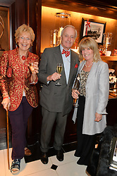 Left to right, CHRISTINE HAMILTON, NEIL HAMILTON and INGRID SEWARD at a party to celebrate the publication of 'A Designer's Life' by Nicky Haslam held at Ralph Lauren, 1 New Bond Street, London on 19th November 2014.