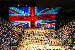 Large Union flag projected onto Edinburgh Castle during Edinburgh International Tattoo part of Edinburgh International Festival 2018 in Edinburgh, Scotland, UK