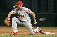 PHOENIX, AZ - JUNE 26:  Brock Stassi #41 of the Philadelphia Phillies fails to catch the throw to first in the third inning of the MLB game against the Arizona Diamondbacks at Chase Field on June 26, 2017 in Phoenix, Arizona.  (Photo by Jennifer Stewart/Getty Images)