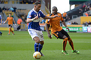 Wolverhampton Wanderers defender Jeremy Helan holds up Ipswich Town midfielder Liam Feeney during the Sky Bet Championship match between Wolverhampton Wanderers and Ipswich Town at Molineux, Wolverhampton, England on 2 April 2016. Photo by Alan Franklin.