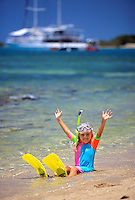 A young girl plays in the shallows of Low Isles off the coast of Port Douglas, far north Queensland, Australia