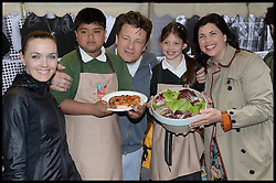 Jamie Oliver launches Food Revolution Day with Victoria Pendleton (L) and Kirstie Allsop ® with children from Rotherfield Primary School. Food Revolution Day Street Party, outside his Fifteen Restaurant, London,.Friday 17th May 2013.Picture by Andrew Parsons / i-Images