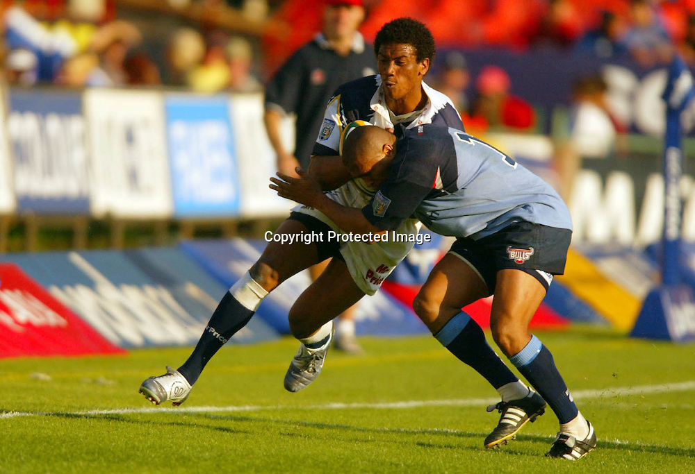 08 May, 2004. Loftus, Pretoria, South Africa. Rugby Union Super 12. Bulls vs Cats. Ashwin Willemse  lgets tackled by  Eddie Fredericks. The Bulls defeated the cats 65 -52.<br /> Pic: Photosport
