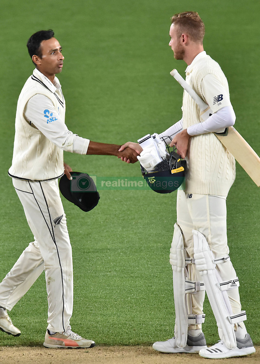 March 26, 2018 - Auckland, Auckland, New Zealand - Jeet Raval (L) of Blackcaps shakes hands with Stuart Broad of England after his team wining the mate during Day Five of the First Test match between New Zealand and England at Eden Park in Auckland on Mar 26, 2018. Blackcaps win by an inners and 48 runs (Credit Image: © Shirley Kwok/Pacific Press via ZUMA Wire)