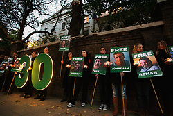 Licensed to London News Pictures 18/10/2013<br /> London.UK.<br /> Greenpeace activists hold a candle lit vigil outside the Russian embassy, on the 30th day of the detention of the Artic 30 activists, held in a Russian jail. <br /> Photo credit: Anna Branthwaite/LNP