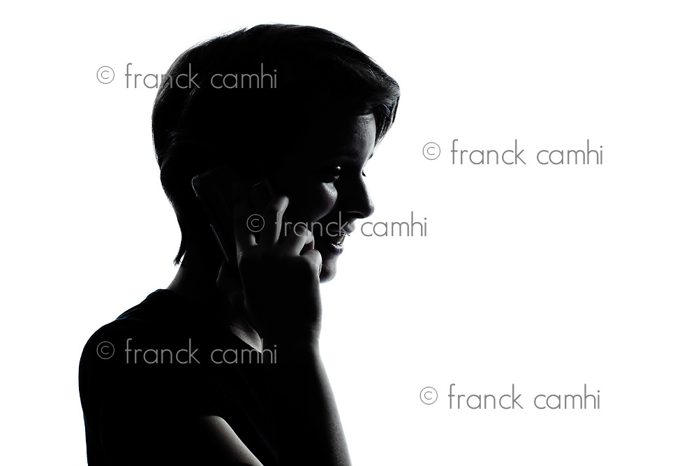 one caucasian young teenager silhouette boy or girl on the telephone  portrait in studio cut out isolated on white background