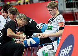 Injured Rune Dahmke of Germany  at medical treatment during handball match between National teams of Germany and Sweden on Day 4 in Preliminary Round of Men's EHF EURO 2016, on January 18, 2016 in Centennial Hall, Wroclaw, Poland. Photo by Vid Ponikvar / Sportida