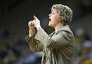 February 18, 2010: Iowa head coach Lisa Bluder signals her team during the second half of the NCAA women's basketball game at Carver-Hawkeye Arena in Iowa City, Iowa on February 18, 2010. Iowa defeated Minnesota 75-54.