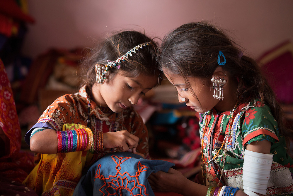 young tribal girls from Bhuj area of Gujarat learning traditional embroidery. They learn from a very young age the textile traditions of their culture.