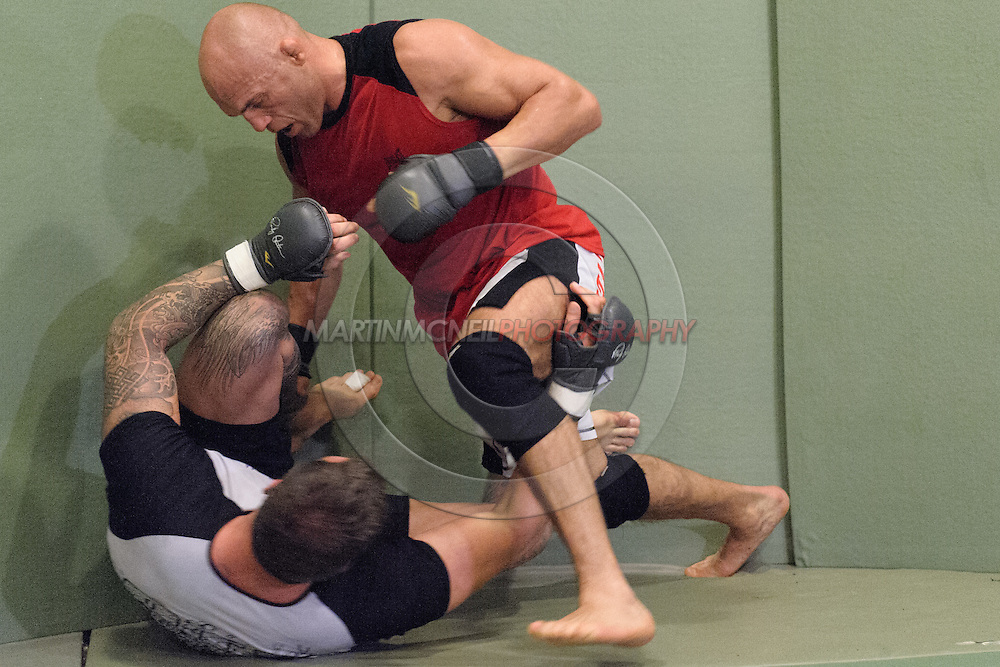 Randy Couture (top) and Neil Melanson work on grappling drills during a training session ahead of UFC 105 at Straight Blast Gym in Manchester, England on November 11, 2009.