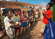 Children crowd around a RARE community singer, Papagaran island, Komodo National Park