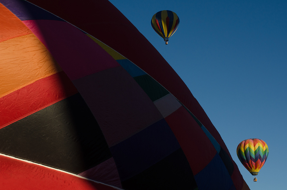 The Albuquerque International Balloon Fiesta takes place in Albuquerque, New Mexico each year drawing in participants and spectators from across the globe. Highlights include an early morning dawn patrol, followed by mass ascencion of aircraft and an evening glow which all take place at the Balloon Fiesta Park throughout the week long event.