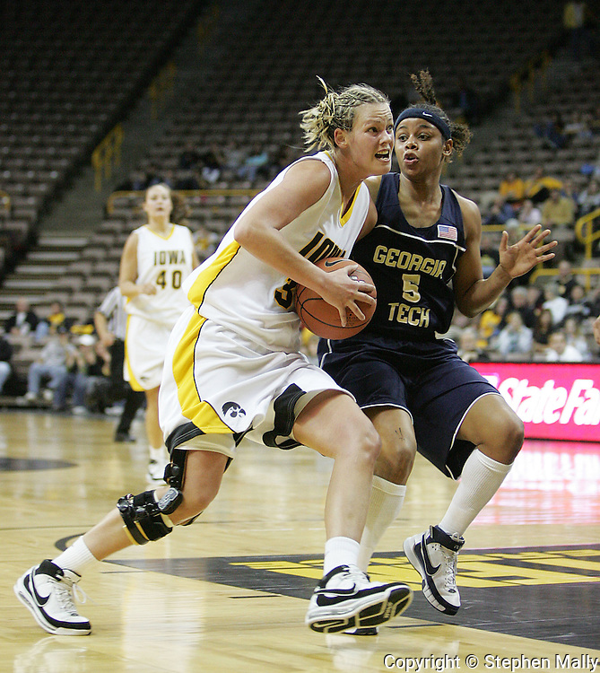 28 NOVEMBER 2007: Iowa forward Johanna Solverson (34) drives to the basket while being guarded by Georgia Tech guard Jill Ingram (5) in the first half of Georgia Tech's 76-57 win over Iowa in the Big Ten/ACC Challenge at Carver-Hawkeye Arena in Iowa City, Iowa on November 28, 2007.