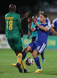 Lehlohonolo Nonyane of Golden Arrows and Dean Furman (C) of SuperSport United clash on the ball during the 2016 Premier Soccer League match between Golden Arrows and Supersport United held at the Princess Magogo Stadium in Durban, South Africa on the 28th September 2016<br /> <br /> Photo by:   Steve Haag / Real Time Images