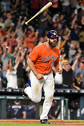 Houston Astros designated hitter Evan Gattis rounds the bases after hitting the game-winning home run in the ninth inning of a baseball game against the Tampa Bay Rays, Friday, Aug. 26, 2016, in Houston. Houston won 5-4. (AP Photo/Eric Christian Smith)
