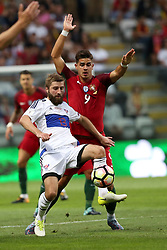 August 31, 2017 - Porto, Portugal - Faroe Islands' midfielder Roaldur Jakobsen (L) vies with Portugal's forward Andre Silva during the 2018 FIFA World Cup qualifying football match between Portugal and Faroe Islands at the Bessa XXI stadium in Porto, Portugal on August 31, 2017. (Credit Image: © Pedro Fiuza/NurPhoto via ZUMA Press)