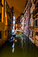 Night time scene of a back canal, Venice, Italy.