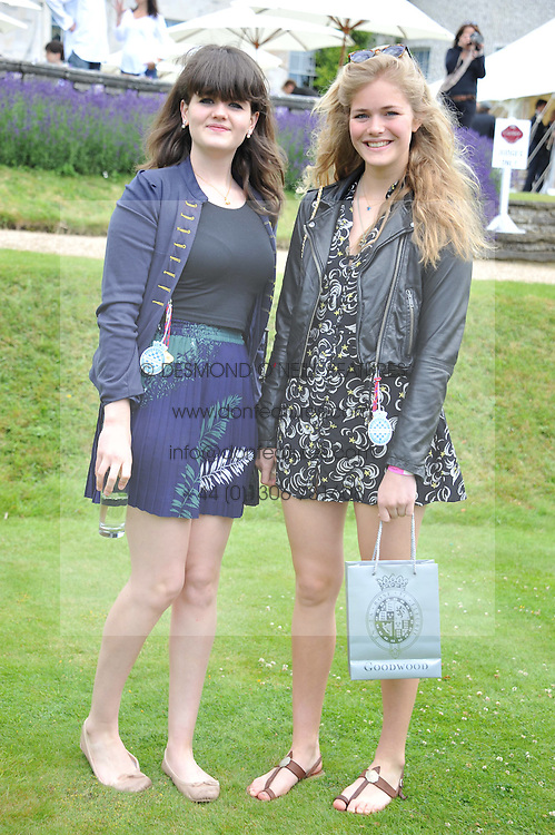 Left to right, sisters MAGDELEINE CASE and NANCY CASE at a luncheon hosted by Cartier for their sponsorship of the Style et Luxe part of the Goodwood Festival of Speed at Goodwood House, West Sussex on 1st July 2012.