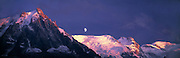 Aiguille du Midi and Mont Blanc on far right, moon rise, Alps, Haute Savoie, France