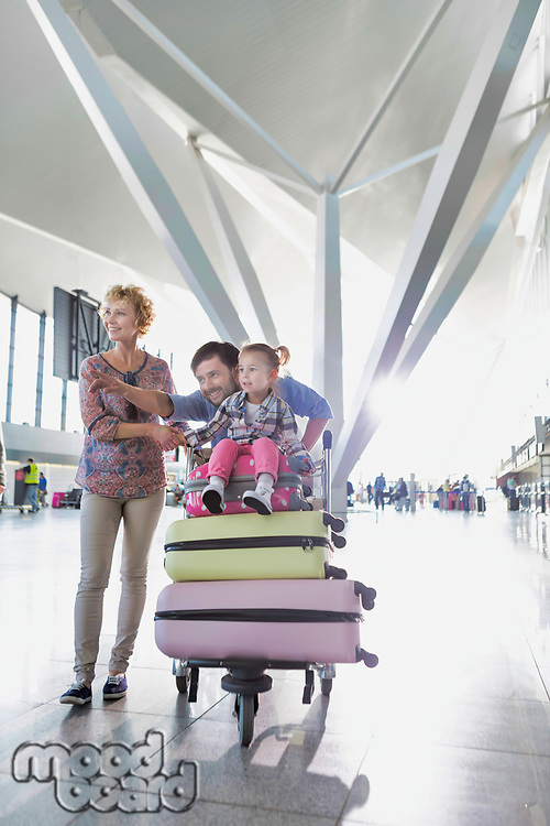 Portrait of happy family going on a holiday in airport