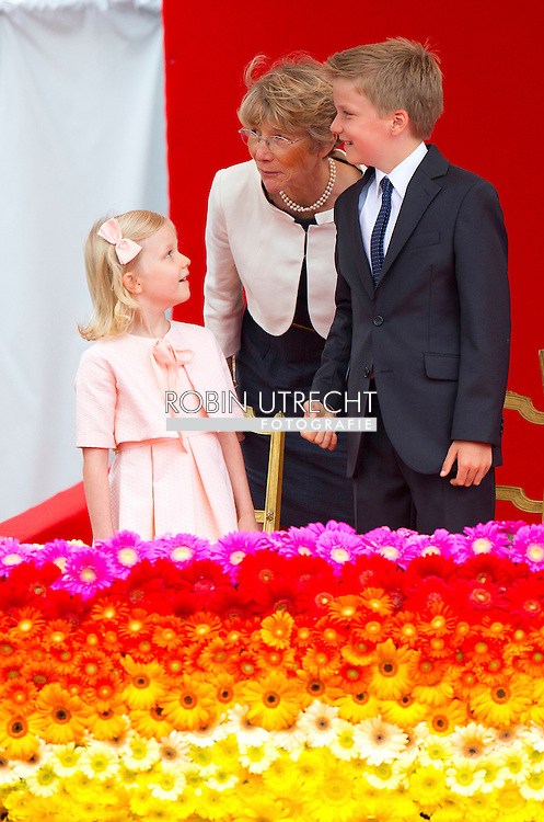 BRUSSELS, BELGIUM: Prince Emmanuel, Crown Princess Elisabeth, Prince Gabriel and Princess Eleonore pictured during the military parade on the Belgian National Day, Monday 21 July 2014.  COPYRIGHT ROBIN UTRECHT