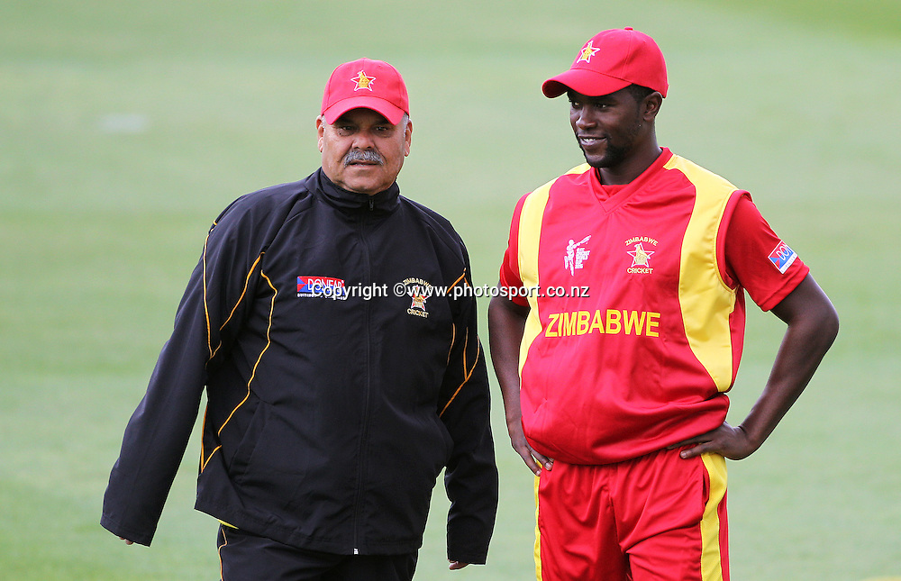 Dav Whatmore coach of Zimbabwe and Elton Chigumbura captain of Zimbabwe before the ICC Cricket World Cup warm up game between the Black Caps v Zimbabwe at Bert Sutcjliffe Oval, Lincoln, Christchurch. 9 February 2015 Photo: Joseph Johnson / www.photosport.co.nz