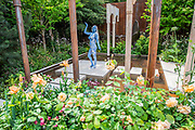 A model in Wedwood Blue on the Wedgwood Show Garden - Press preview day at The RHS Chelsea Flower Show.