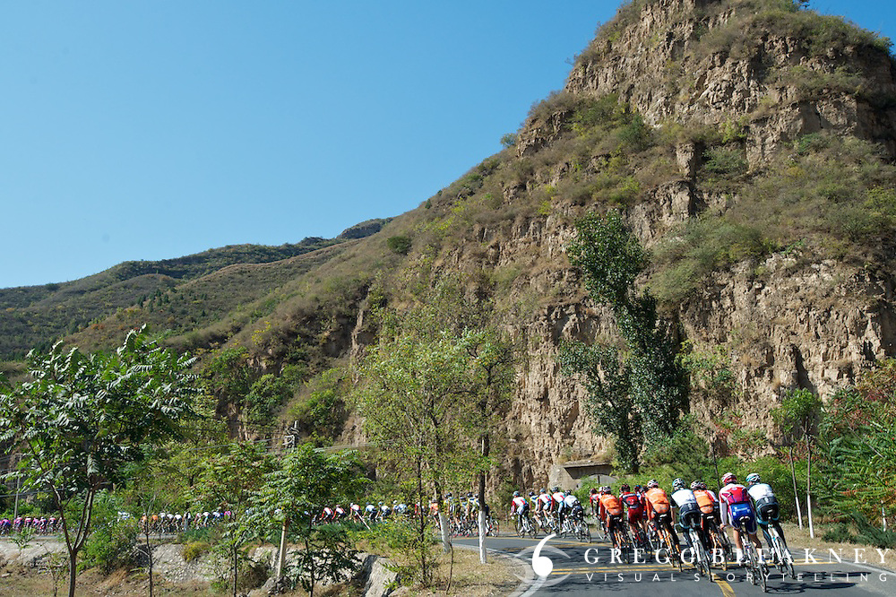 Ten kms into the day, the rout tipped upward and the cyclists began climbing 1,100 meters through the mountains on the outskirts of Beijing.