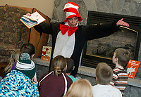 "The Cat in the Hat reads Dr. Seuss' ""Green Eggs and Ham"" to children at the Gilford Library during their Read Across American event.  (Karen Bobotas Photographer)"