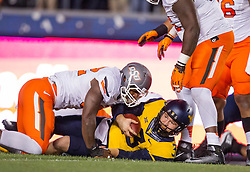 Oct 10, 2015; Morgantown, WV, USA; West Virginia Mountaineers quarterback Skyler Howard lays on the ground after being sacked during the first quarter against the Oklahoma State Cowboys at Milan Puskar Stadium. Mandatory Credit: Ben Queen-USA TODAY Sports
