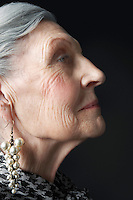 Senior Woman with Pearl Earrings
