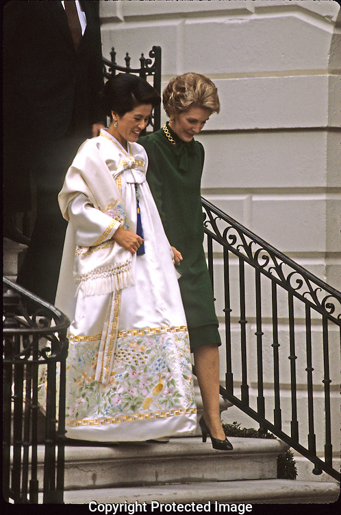 First Lady Nancy Reagan and First Lady of South Korean Lee Soon,Ja, wife of President Chun Doo-Hwan at an arrival ceremony on the South Lawn of the White House in 1981...Photograph by Dennis Brack bb 34