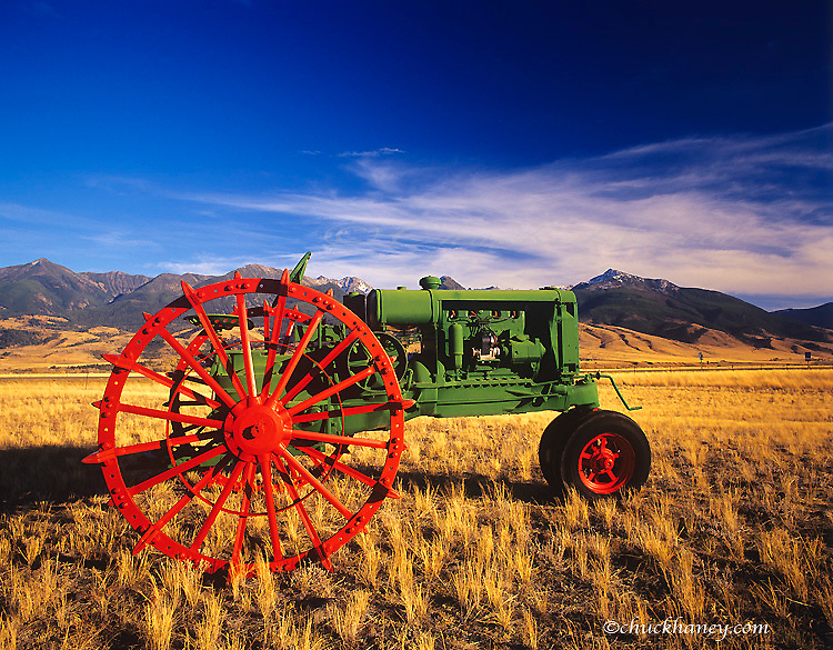 Early 1930's Oliver Hart Parr Tractor with Absaroka Mtountains in background restored by Mike West of Emigrant, Montana