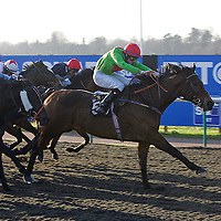 The Strig and William Carson winning the 1.35 race