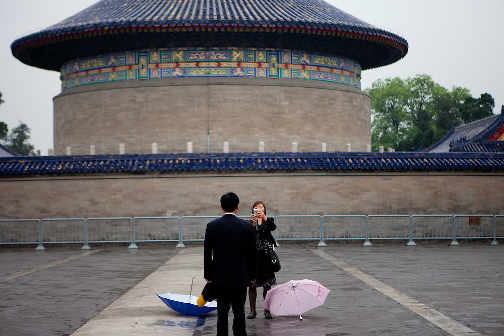 "Woman taking a photograph of her husband at ""The Temple of Heaven"" which is a complex of Taoist buildings situated in the southeastern part of central Beijing. Beijing is the capital of the People's Republic of China and one of the most populous cities in the world with a population of 19,612,368 as of 2010."