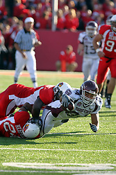 18 October 2008: Jermaine Malcolm helps Kelvyn Hemphill bring down Clay Harbor as Harbor reaches for extra inches near the goal line in a game which the Missouri State Bears came from behind to beat the Illinois State Redbirds 34-28 in front of 13,292 fans at Hancock Stadium on Illinois State Universities campus in Normal Illinois