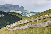 Schlern/Sciliar mountain rises above Seiser Alm/Alpe di Siusi, the largest Alpine meadow in Europe. For a scenic walk from Selva di Val Gardena, take the Ciampinoi lift for views of Alpe di Siusi then hike to Passo Sella and return by bus. The beautiful ski resort of Selva di Val Gardena (German: Wolkenstein in Gröden; Ladin: Sëlva Gherdëine) makes a great hiking base in the Dolomites, in the South Tyrol region (Trentino-Alto Adige/Südtirol) of Italy, Europe. UNESCO honored the Dolomites as a natural World Heritage Site in 2009.