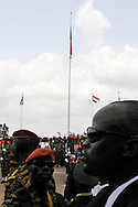 The raising of the new flag of the Republic of South Sudan at the official independence day ceremony. After decades of conflict, Southern Sudan declared independence from the North on July 9th, 2011. Government officials, foreign dignitaries and ordinary people came to the John Garang Memorial in the capital from all over the country and the world to celebrate the historic occation..Juba, South Sudan. 09/07/2011..Photo © J.B. Russell