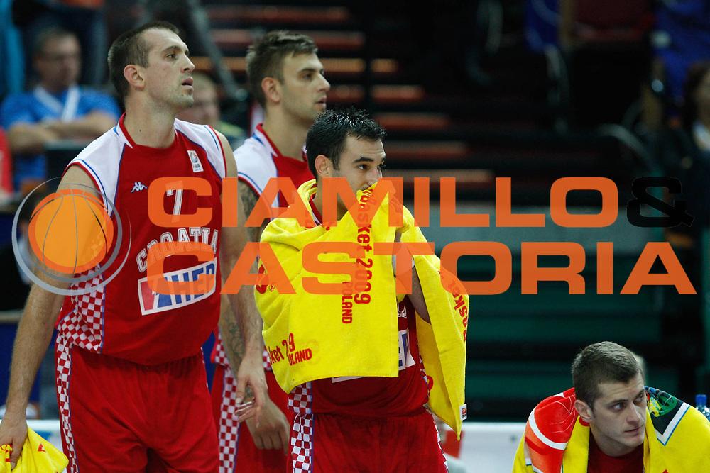 DESCRIZIONE : Katowice Poland Polonia Eurobasket Men 2009 Quarter Final Slovenia Croazia Slovenia Croatia<br /> GIOCATORE : Marko Popovic  Nikola Vujcic<br /> SQUADRA : croazia croatia<br /> EVENTO : Eurobasket Men 2009<br /> GARA : Slovenia Croazia Slovenia Croatia<br /> DATA : 18/09/2009 <br /> CATEGORIA : delusione<br /> SPORT : Pallacanestro <br /> AUTORE : Agenzia Ciamillo-Castoria/M.Kulbis<br /> Galleria : Eurobasket Men 2009 <br /> Fotonotizia : Katowice Poland Polonia Eurobasket Men 2009 Quarter Final Slovenia Croazia Slovenia Croatia<br /> Predefinita :
