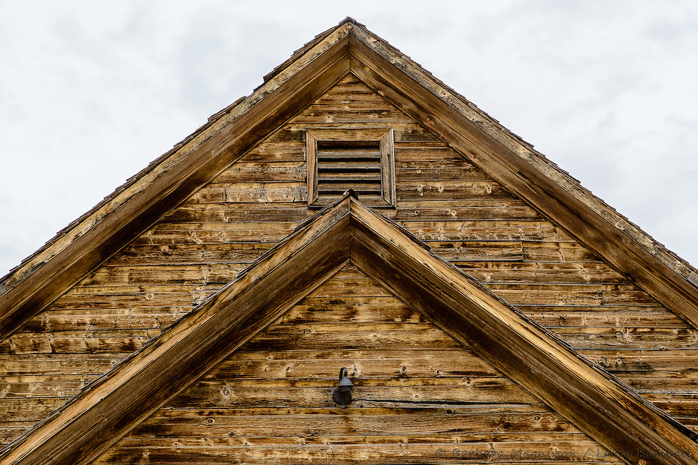 Old abandoned schoolhouse or community building front roof facade; Caineville, UT