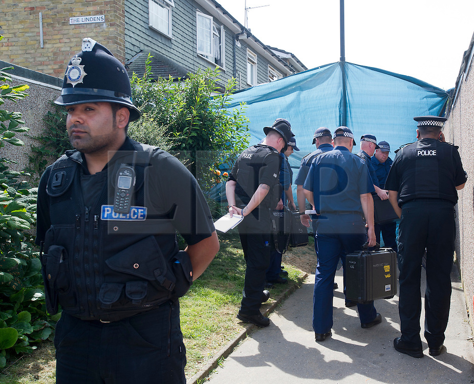 © Licensed to London News Pictures. 11/08/2012 . A police search team entering The Lindens, New Addington following an announcement of two further arrests,  in the hunt for missing 12 year-old schoolgirl Tia Sharp. Photo credit : LNP