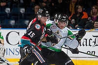 KELOWNA, CANADA - NOVEMBER 12: Tomas Soustal #15 of the Kelowna Rockets checks Luke Coleman #28 of the Prince Albert Raiders during second period on November 12, 2016 at Prospera Place in Kelowna, British Columbia, Canada.  (Photo by Marissa Baecker/Shoot the Breeze)  *** Local Caption *** Tomas Soustal; Luke Coleman;