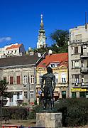 city scene from Danube; statue; buildings; church on hill; Belgrade; Serbia; summer