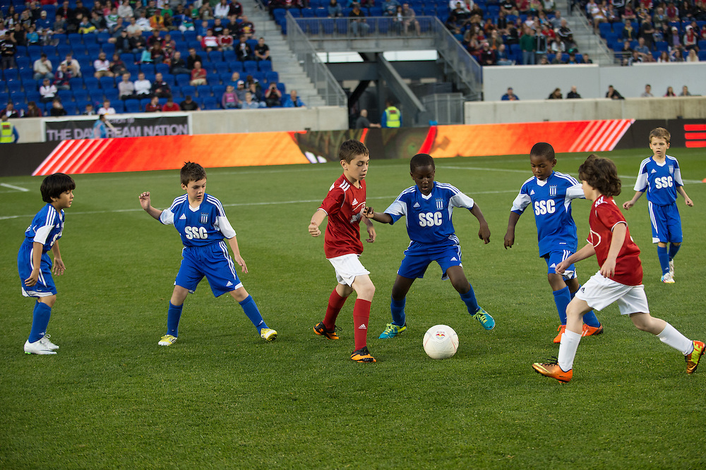 HARRISON, NJ - MAY 24: Youth soccer teams play during half time of the match between the New York Red Bulls and the Portland Timbers at Red Bulls Arena on May 24, 2014. (Photo By: Rob Tringali)
