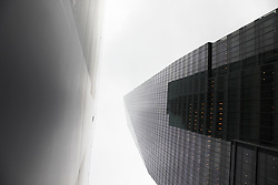 looking up at two glass buildings in New York City