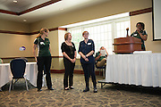 From right to left, Jennie Daniels, Brianna Dowler, and Elana Harnish recieve pins from Renea Morris, the Chief Marketing Officer for University Communications and Marketing, to recognize the completion of the UCM University certificate at the Campus Communicator Network Expo in Nelson Commons on Wednesday, May 11, 2016. © Ohio University / Photo by Kaitlin Owens