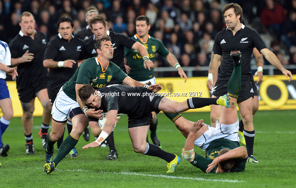 Cory Jane takes the ball forward. The Rugby Championship test match, New Zealand All Blacks versus South Africa Springboks. Dunedin. New Zealand. Saturday 15 September 2012. Mandatory Photo Credit: © Andrew Cornaga/Photosport.co.nz